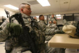 Major Andrew Olmsted listens to a briefing of their mission as part of a training exercise at Fort...