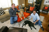 Ron Werner, left,  and his partner, Jim Hering, owners of HW Home, with their dogs, Zach, left,...