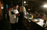 1433 Renowned chef Emeril Lagasse embraces a member of the audience, Sheila Owen, CQ, 61, of...