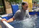 "Dennis Velasquez (cq),  from Lakewood, gets ""dunked"" by his daughter, Heather Velasquez..."
