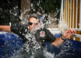 Keith Schneider (cq), the West Metro Fire Chief for District 1, gets dunked as part of a...
