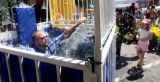 "Chris Lynch(cq),  from Lakewood, gets ""dunked"" by his daughter, 4 year-old Allison Lynch..."