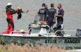 Members of the Littleton Fire and Rescue and State Park Rangers  search for a missing boater at...