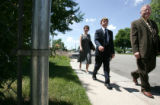 (L-R) Sonya, Ethan,8  and Dave Graalum walk together  in a Littleton neighborhood Sunday June 17,...
