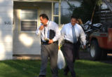 Denver, Colo., photo taken Sept. 13, 2004-Denver crime investigators leave the residence of 5120...