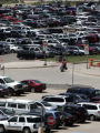 A traveler looks for her car in the outer lot  at  DIA Monday afternoon June 18, 2007. The summer...