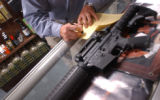 [Aurora, CO - Shot on: 9/13/04] Gary Hazen, 38, of Lone Tree signs a government issued Firearms...