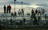 Getting good spots on stand the crowd waits for the race to start at the Colorado National...