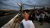 Train driver Kathy Calkins cheers during anothe race at the Colorado National Speedway, in Erie,...