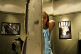 Demi Fullmer, 9, of Parker, Colo, looks at a piece of the World Trade Center at the exhibit ...