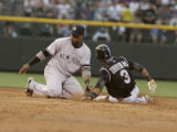 (DS-a-317) - Colorado Rockies center fielder Willy Taveras successfully steals second base in the...