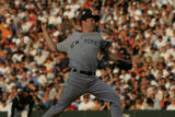 (JOE-a-020) - New York Yankees pitcher Mike Mussina delivers a pitch in the bottom of the second...