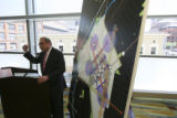 Evan Makovsky gestures beside a city diagram during his press conference. The Downtown Denver...