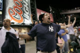 Dimitri Valerga (cq) of Thornton, Colo., screams in disbelief as the Yankees end the 8th inning...