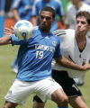 MODW107 - Kansas City Wizards' Scott Sealy (19) battles D.C. United's Devon McTavish for control...