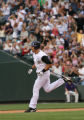 Rockies Ryan Spilborghs, rounds the bases, after hitting a grand slam homerun, in the bottom of...