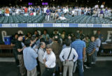 0027 New York Yankees manager Joe Torre get mobbed by the media before the second game of a three...