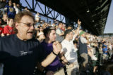 Rod Jerke, (cq) left, and his son Raine Jerke, right, of Sioux Falls, S.D., cheer on the Yankees...