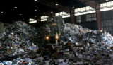 A loader piles up recyclables, so the sorting process can begin, Friday afternoon, June 29, 2007,...