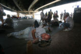 Yankee fan, Stephan Dempsey (cq), of Denver, sleeps while waiting in line for Rock Pile tickets...