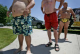 CODER101 - Belly's line up for the 11th annual Water World Belly Flop Contest on Thursday June 21,...
