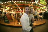 Nick Hodgdon (cq) and Laura Munro (cq) of Denver enjoy themselves at the Denver Zoo, in Denver,...
