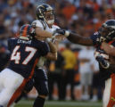 (Denver, Col, September 26, 2004)  Denver Broncos John Lynch, left, hits San Diego Chargers...