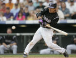 0816 Colorado Rockies Kazuo Matsui eye a pitch he drilled up the middle for a single against the...