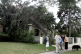 Neighbors check out the damage to Martha Masko's  house, in orange to right,  at 2622  Hudson...