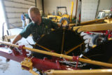 DLM0453  Shawn Lindsey assembles a hay rake at the Kay Jan Inc. John Deere dealership in Fort...