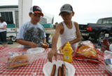 Chris Archuleta, left, 10, and his cousin Andrew Azzam, 9, ready their hot dogs for lunch at their...