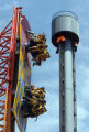 "Thrill seekers ride the ""Half Pipe"" at Denver's Elitch Gardens, as the ""Tower of..."