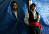 George Kyriazi, 12, (CQ), left, and Joseph Priddy(CQ), 11, wait to take the stage with their dance...