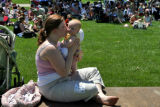 DLM0002  Heather Wilcox kisses her 5-month-old daughter Rachel during the National Mile High...
