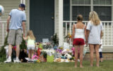 A steady stream of mourners add gifts to the memorial on the fronts steps of Jessie Davis' home on...