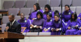 Bishop F. Josephus Johnson II prays for the family of Jessie Davis and baby Chloe during morning...