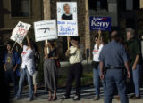 Greenwood Village, Colo.-September14,2004- Protesters hold signs outide of the Coors Amphitheatre ...