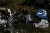 DLM0875  Recovery workers from Beegle's Aviation pick up the charred remains of a single engine...