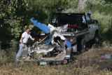 DLM0985  Recovery workers from Beegle's Aviation pick up the charred remains of a single engine...