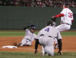 [RMN1018] Colorado Rockies Willy Taveras slides into third after a throwing error by Red Sox third...
