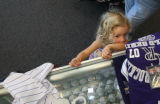3 year-old Elliot Fox (cq) looks through the glass at some baseballs at the Diamond Dry Goods...