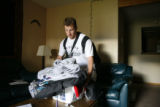 DM0429   Ryan Bird quickly packs up some of his stuff at his place at the Gold Run Condominiums...