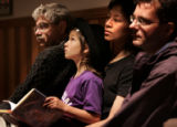 (9/28/2004) Boulder, Colorado-Sarah Pao Radzihovsky, 7, sits on her mother Lucy Pao's lap as...