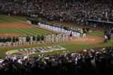 [333} Colorado Rockies and the Boston Red Sox line up for the National Anthem before Game 3 of the...