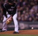 [RMN1103] Colorado Rockies pitcher Josh Fogg ducks as a hit from J.D. Drew skips by (fielded by...