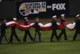 [359} Member of the Armed Forces carry the American Flag on to Coors Field, as the Colorado...