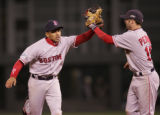 [2610]  Boston Red Sox shortstop Julio Lugo celebrates with Dustin Pedroia after catching Jeff...