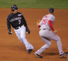 [748]  Colorado Rockies Kaz Matsui is tagged out by Boston Red Sox  third baseman Mike Lowell in a...