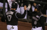 [2058} Colorado Rockies, is congratulated by Yorvit Torrealba after scoring  the Rockies first run...