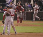 [3745} Boston Red Sox players alex Cora and Julio Lugo congratulated each other after a 10-5 win...